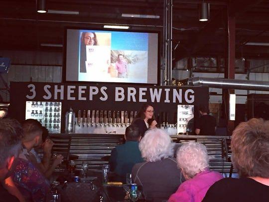 Sheboygan Press editor Leah Ulatowski speaks at Ignite Sheboygan at 3 Sheeps Taproom on Aug. 14.