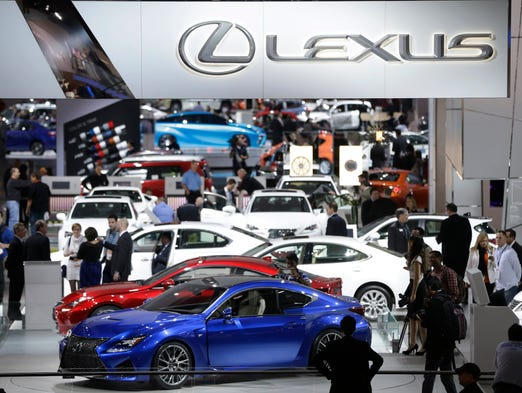People walk around the Lexus display at the North American International Auto Show on Jan. 14 in Detroit.