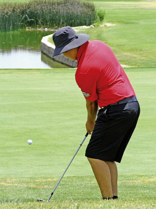 """Headlight File Photo   Deryk """"Buzz"""" Perales chips from the rough during the 2015 Rio Mimbres Men's Club Championship. Perales won the club title two week's ago and is the defending champion for today's start of the 62nd annual Rio Mimbres Invitational Tournament."""