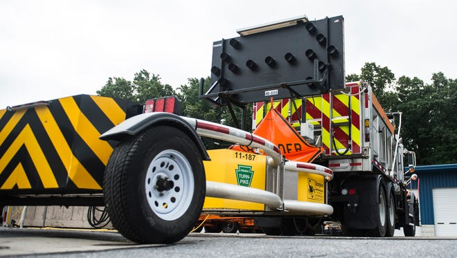 A trailered attenuator  -- a device that lessens the impact of rear end collisions -- is attached to a dump truck at the Mount Gretna Pennsylvania Turnpike Maintenance Shed on Monday, July 5, 2016.