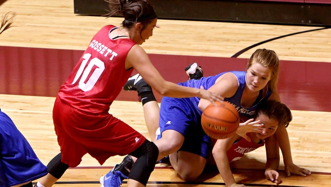 Richland Springs' Jordan Gossett (10) battles for a loose ball with Spur's Emily White and  Lueders-Avoca's Cheyenne Campbell (bottom on floor) during the TSMCA's girls all-star basketball game at D.L. Ligon Coliseum Saturday afternoon.