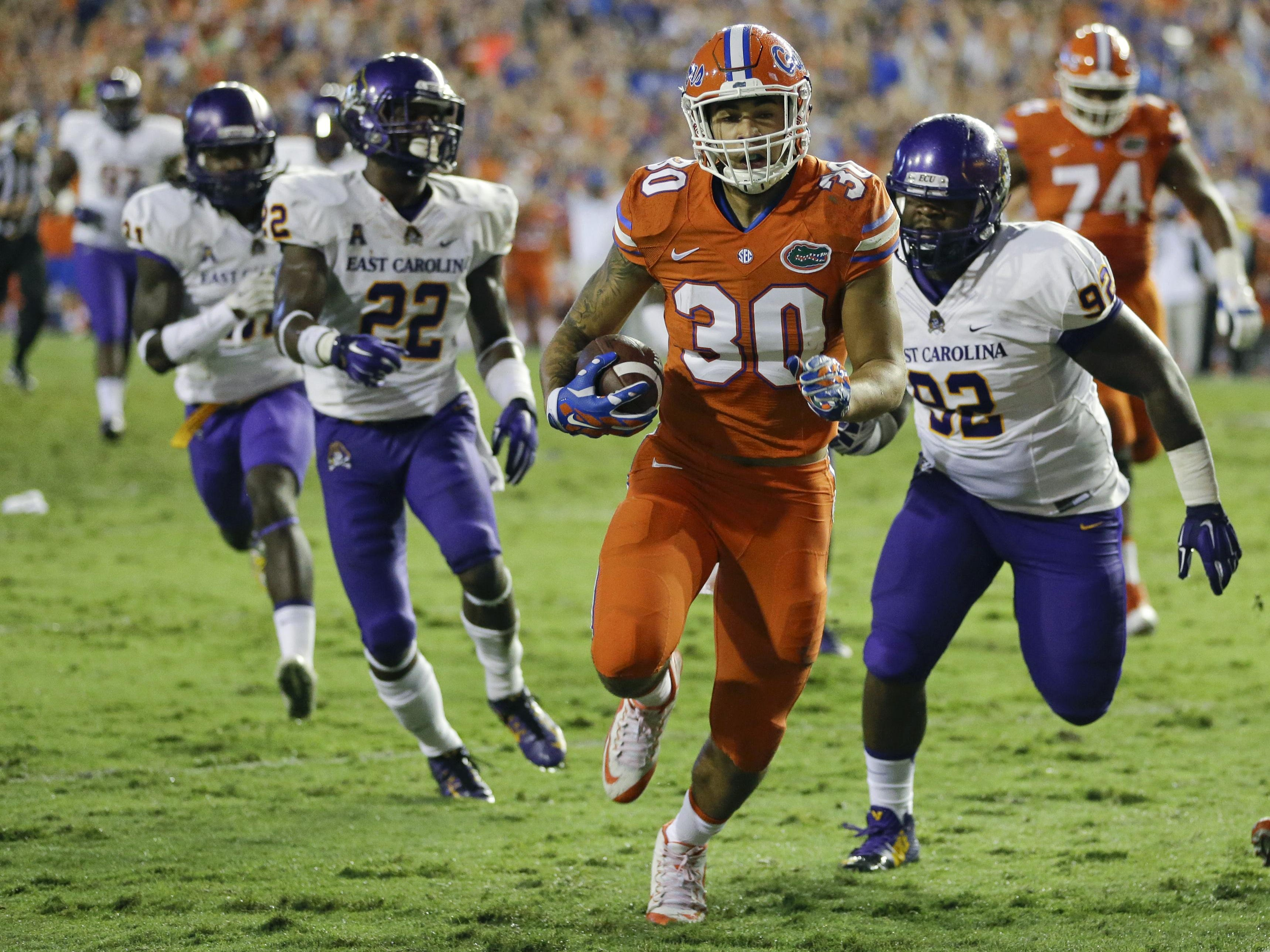 Florida tight end DeAndre Goolsby (30) runs past East Carolina nose tackle Mike Myers (92) and defensive back Terrell Richardson (22) for a touchdown on a 32-yard pass play Saturday night.