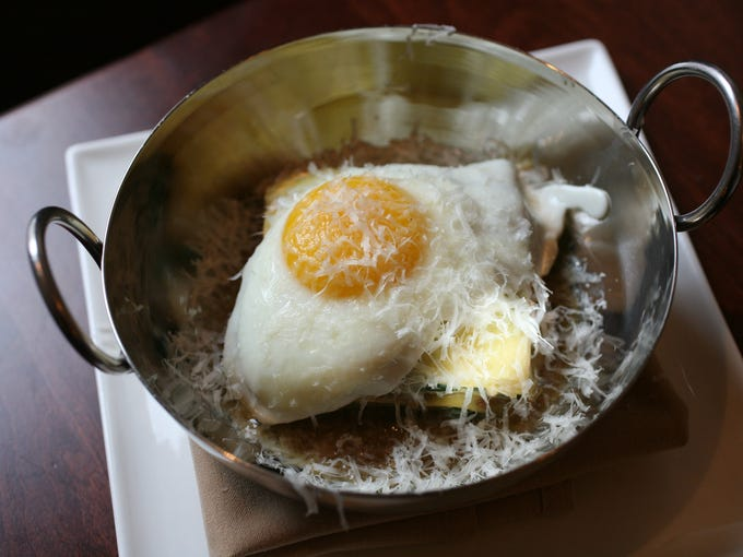 The John Fazio Farms Duck Lasagna with kale and farm egg, at The Twisted Oak in Tarrytown, photographed Jan. 21, 2014. ( Mark Vergari/The Journal News )