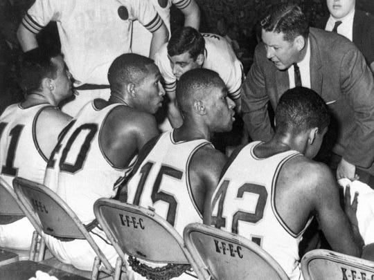 Loyola coach George Ireland talks with his team during the 1963 NCAA title game vs. Cincinnati. Chuck Wood, the team's sixth man from Racine, is to Ireland's right. Seated (left to right) are starters John Egan, Vic Rouse, Jerry Harkness and Ron Miller.
