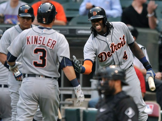 Detroit Tigers' Cameron Maybin (4) celebrates with Ian Kinsler (3), after Kinsler'ssolo home run during the first inning of a baseball game against the Chicago White Sox on Monday, June 13, 2016, in Chicago. (AP Photo/Paul Beaty)
