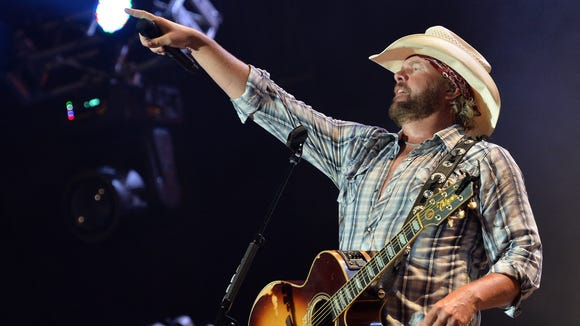 Toby Keith performs during the Oklahoma Twister Relief Concert at the Gaylord Family Oklahoma Memorial Stadium in 2013.