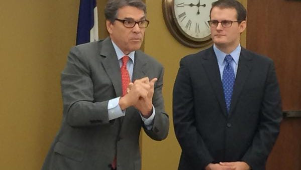 Texas Gov. Rick Perry alongside Republican attorney general candidate Adam Gregg.