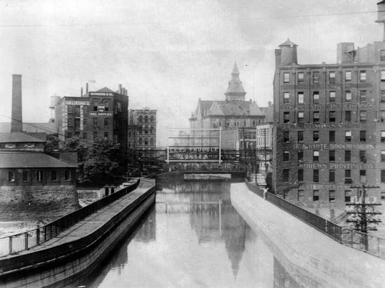 Lawyer's Co-op and City Hall in 1923 photo of Erie Canal where Broad Street now runs.