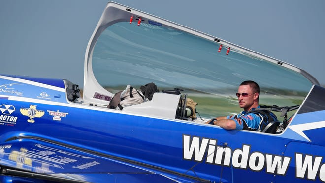 'The (plane) just fits my 'personality' in the air,' says air show pilot Rob Holland. 'I don't get in it. I put it on (and) it just becomes an extension of myself.'