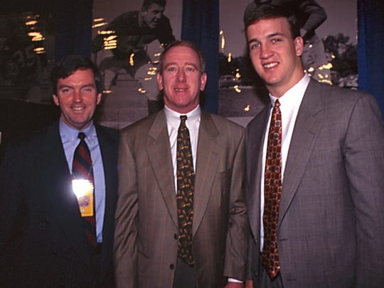 Then-Indianapolis Colts vice president of public relations Craig Kelley, a Marco Island resident, with Archie Manning and Colts quarterback Peyton Manning after the Colts selected Manning in 1998.