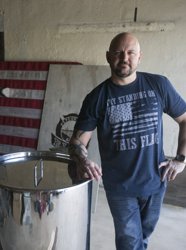 Christopher Lucidi, founder and distiller of the Lucidi Distilling Co. at the Historic Fire Station No. 1, stands next to a distilling tank at the fire station in Old Town Peoria.