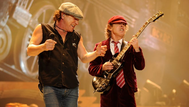 """Singer Brian Johnson (left) and Angus Young of AC/DC perform during their """"Black Ice"""" Tour Opener on October 28, 2008 in Wilkes-Barre, Pennsylvania."""