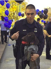 """Wayne State police officer Collin Rose honors the memory of fallen DPD Officer Patrick Hill by naming his new K9 partner """"Wolverine"""" which was Hill's code name."""