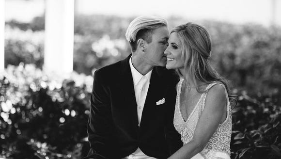 Pittsford native Abby Wambach and her wife, Glennon,