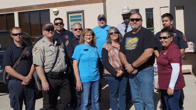 First National Bank hosted a fundraiser to help rebuild the Otero County Fallen Officer Memorial after it was vandalized Oct. 31. The Alamogordo Chamber of Commerce, Alamogordo High School Cheerleaders and the Pipe Hitters Union Motorcycle Club—Knights Chapter made donations at the event Nov. 10. The event raised over $5,000 for the rebuilding of the Fallen Officer Memorial.