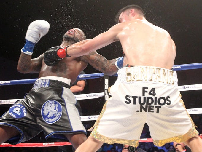 "Action between Eddie Gomez (in dark trunks) versus Fracisco Santana during the ShoBox ""The New Generation"" fight card at Fantasy Springs Resort Casino on June 6, 2014. Santana won the fight by unamimous decision."