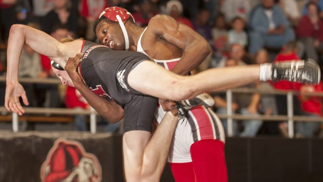 Paulsboro's George Worthy takes down Haddonfield's Ben Klaus during the 138 lb. bout of Wednesdays wrestling match held at Haddonfield High School.  Worthy won 17-5.