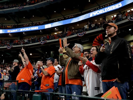 Fans cheer during the first inning of Game 4 of baseball's