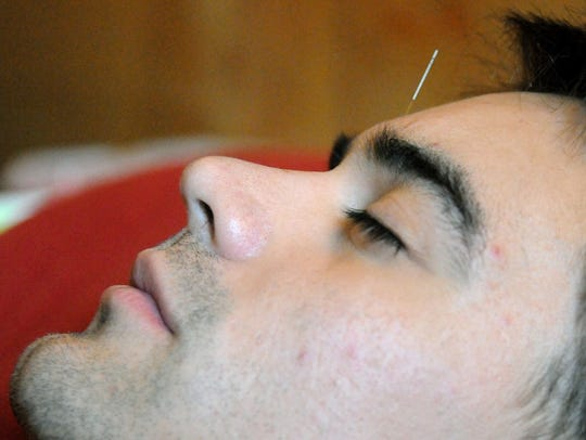 Angel Flores of El Paso rests at Crossroads Acupuncture