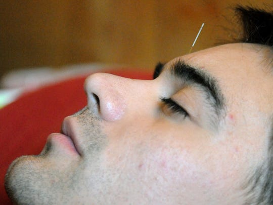 Angel Flores of El Paso rests at Crossroads Acupuncture while receiving treatment in December 2014.