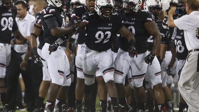 The UC defense celebrates a stop against Alabama A&M on Saturday night.