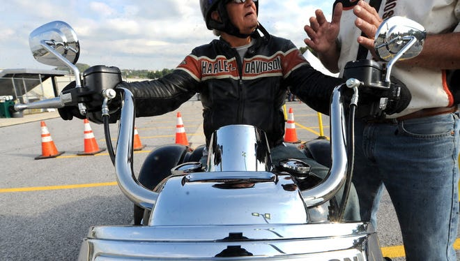 Keith Lenker of Columbia prepares to test ride a Harley-Davidson motorcycle during the company's open house in 2014.