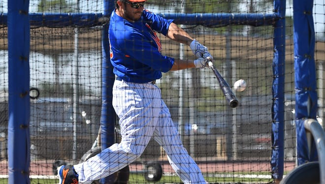 Travis d'Arnaud has a more compact swing.