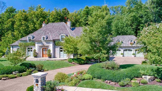 8629 Copper Creek Drive in Newburgh is a 6,967 square foot authentic French country design.