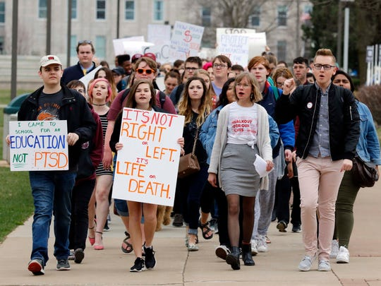 Students march at The Gun Violence Protest at the Missouri State campus on March 23, 2018.