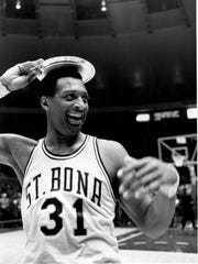 Bob Lanier of St. Bonaventure puts his MVP trophy on his head after his team won the ECAC Holiday Festival basketball tournament at New York's Madison Square Garden on Dec. 31, 1969.  St. Bona defeated Purdue 91-75.