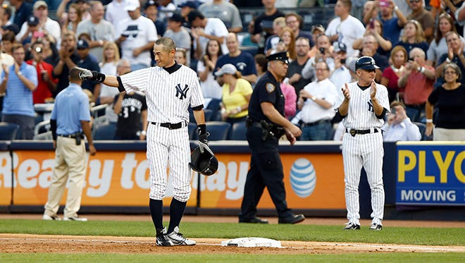 New York Yankees right fielder Ichiro Suzuki (31) waves to the crowd after recording his 4000th career hit during the first inning against the Toronto Blue Jays at Yankee Stadium.