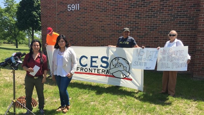 Katherine Torres, front right, stands with workers' and immigrant rights' group Voces de la Frontera outside the Greendale police building Friday before she filed a complaint alleging racial profiling by a police officer.