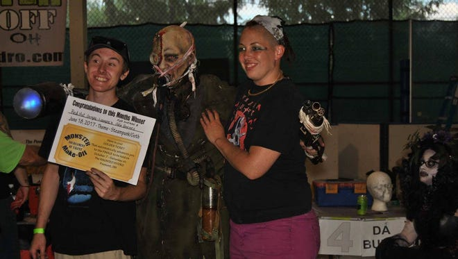 From left, Kyle Dickman, artist, Jacob Friesel, model, and Julie Barnes, artist, win first place Sunday during a preliminary round of the Monster Make-Off challenge.