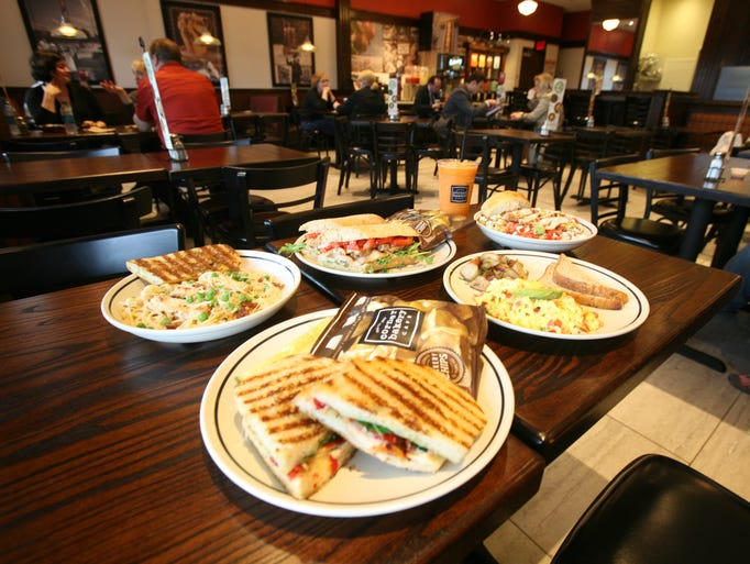 Clockwise from bottom: Chicken Pomodori panini; Chicken Carbonara pasta; Chicken Pesto on a cibatta ficelle; Orange Carrot Ginger smoothie; chopped salad and Anaheim scrambler at the Corner Bakery Cafe at The Shops at Nanuet, May 15, 2014.