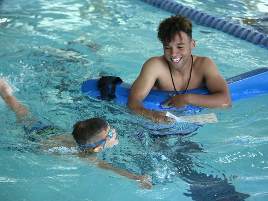 Mason Sine teaches Cadel Laborda how to swim at Fairmont Aquatic Center in Salt Lake City on Tuesday, May 22, 2018.
