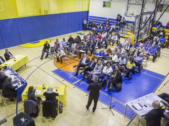 Community members attend a Wilmington Public Safety Strategies Commission meeting on March 10, 2015, at Hicks Anderson Community Center. The center recently received a new executive director.
