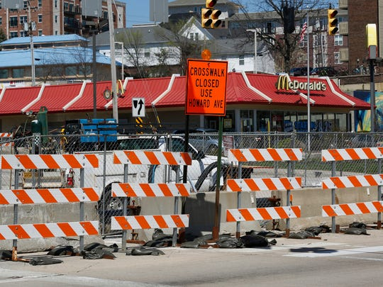 Barricades and fencing block State Street at River