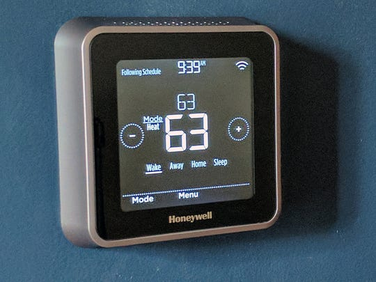 The Honeywell Lyric T5 Wi-Fi Thermostat after you tap it to change functions.