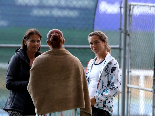 Professional tennis player Ulrikke Eikeri, right, and her mom Siv, left, talk with Eikeri's doubles partner Caitlin Whoriskey on Thursday during the The Ascension Project Women's $25,000 Challenger tournament.