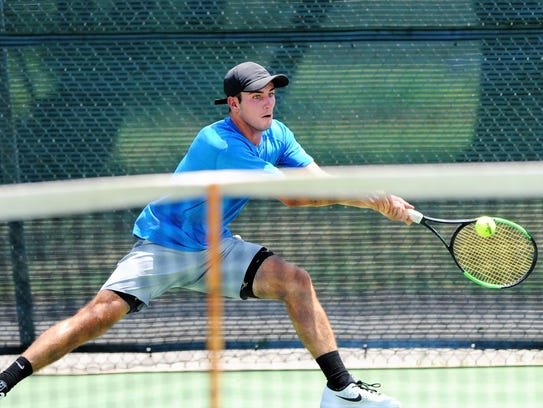 Wylie's Lane Adkins reaches for a backhand during the USTA Texas Slam at Mann Middle School on Monday. Adkins won 6-0, 6-1 to advance in the Boys' 18 consolation bracket.
