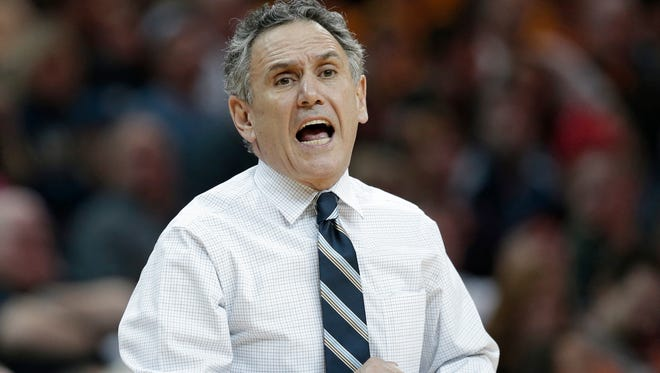 Akron coach Keith Dambrot yells instructions to players during a game against Kent State.