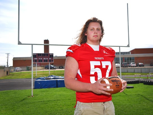 Lincoln High offensive lineman Grant Treiber Thursday, May 10, at Lincoln High School. Treiber is being recruited by a collection of major Division I college football programs.