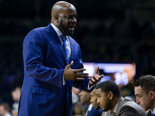 Hampton head coach Edward Joyner Jr. talks to his players against Notre Dame during an NCAA college basketball game in the first round of the NIT tournament, Tuesday, March 13, 2018, in South Bend, Ind.   (Michael Caterina/South Bend Tribune via AP)