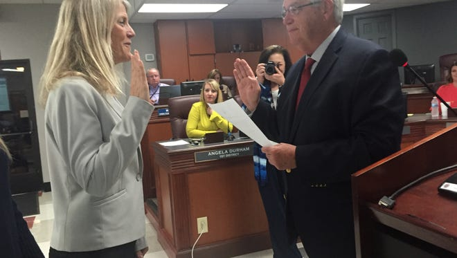 Williamson County Mayor Rogers Anderson, right, swears in Sheila Cleveland as the interim school board member for District 7.