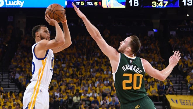 Golden State Warriors guard Stephen Curry (30) shoots the basketball against Utah Jazz forward Gordon Hayward (20) during the first quarter in Game 1.