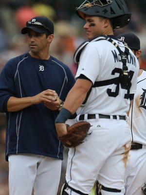 Tigers manager Brad Ausmus, left, and catcher James McCann talk on the mound amid a seventh-inning pitching change against the White Sox on June 25 at Comerica Park.