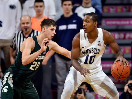 Michigan State's Matt McQuaid guards Penn State's Tony