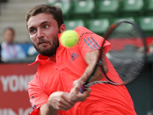 Gilles Simon, of France, returns a shot against Germany's Philipp Kohlschreiber, during their singles match at the Japan Open men's tennis tournament in Tokyo, Tuesday, Oct. 4, 2016. (AP Photo/Eugene Hoshiko)