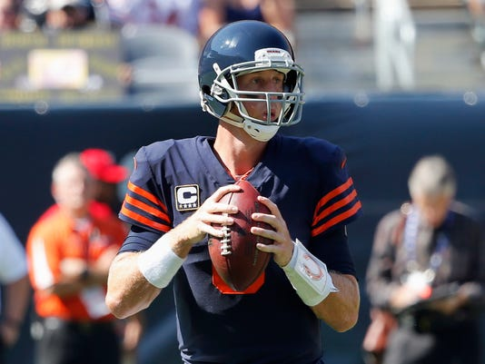Chicago Bears quarterback Mike Glennon (8) looks for a receiver during the first half of an NFL football game against the Pittsburgh Steelers, Sunday, Sept. 24, 2017, in Chicago. (AP Photo/Charles Rex Arbogast)