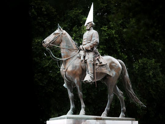 A white hood perches on the head of the Nathan Bedford Forrest in Health Sciences Park Monday afternoon before UT security noticed the hood and had it removed.